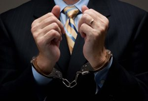 Executive in handcuffs